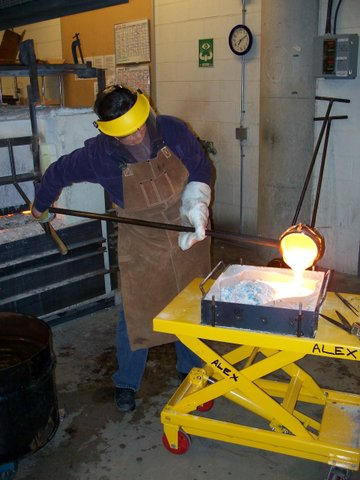 hot glass into a sandcasting mold
